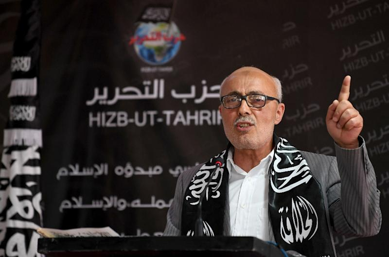 Abderraouf Amri, head of the Political Bureau for the radical Islamist group Hizb ut-Tahrir, delivers a speech at its headquarters on April 15, 2017 (AFP Photo/FETHI BELAID)