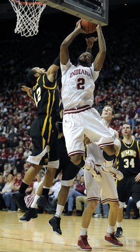 Indiana's Christian Watford (2) drives to the hoop over UMBC's Ryan Cook, left, during the first half of an NCAA college basketball game, Thursday, Dec. 22, 2011, in Bloomington, Ind. (AP Photo/Alan Petersime)