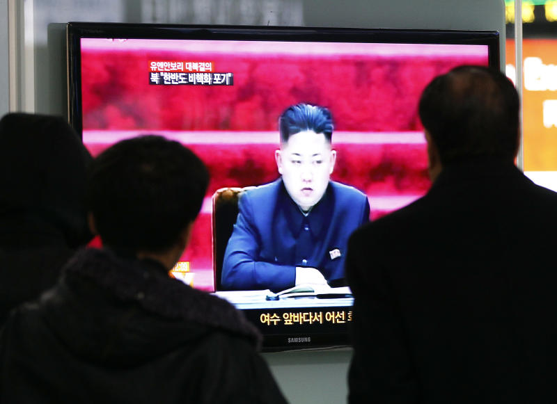 People watch TV showing North Korean leader Kim Jong Un at Seoul Railway Station in Seoul, South Korea, Wednesday, Jan. 23, 2013. North Korea swiftly lashed out against the U.N. Security Council's condemnation of its December launch of a long-range rocket, saying Wednesday that it will strengthen its military defenses - including its nuclear weaponry - in response.(AP Photo/Ahn Young-joon)
