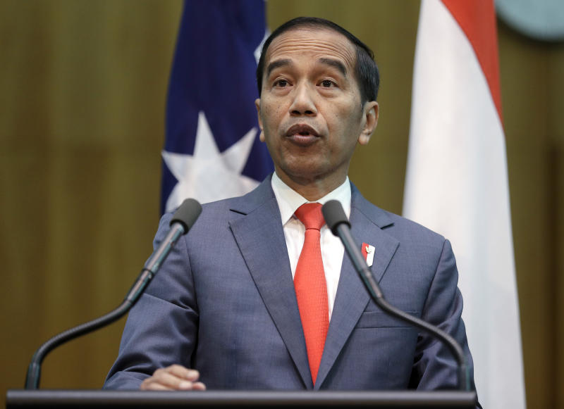 Indonesia's President Joko Widodo gives a joint statement with Australia's Prime Minister Scott Morrison at Parliament House in Canberra, Monday, Feb. 10, 2020. Widodo is on a two-day visit to Canberra, his fourth visit to Australia. (AP Photo/Rick Rycroft, Pool)