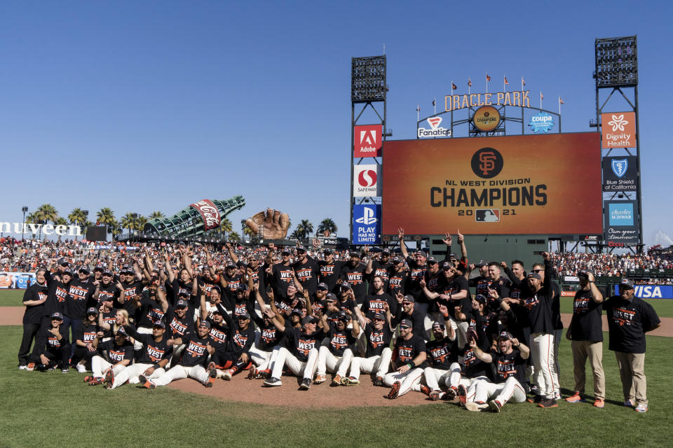 The San Francisco Giants celebrate after defeating the San Diego Padres in a baseball game in San Francisco, Sunday, Oct. 3, 2021. The Giants won the National League West title. (AP Photo/John Hefti)