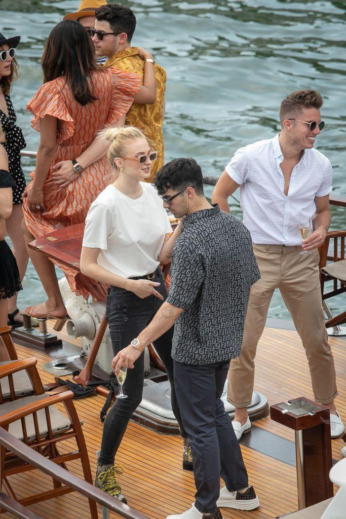 <p>Sophie Turner and Joe Jonas party abord the boat 'Shivas' while on a cruise with Priyanka Chopra, Nick Jonas and friends, ahead of their French wedding, June 2019.</p>
