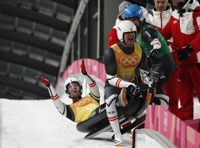 Luge - Pyeongchang 2018 Winter Olympic Games - Team Relay - Pyeongchang, South Korea - February 15, 2018 - Peter Penz and Georg Fischler of Austria celebrate with team mates. REUTERS/Edgar Su