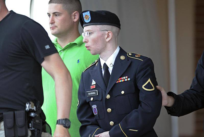 Army Pfc. Bradley Manning is escorted out of a courthouse at Fort Meade, Md., on the fourth day of his court martial, Monday, June 10, 2013. Manning is charged with indirectly aiding the enemy by sending troves of classified material to WIkiLeaks. He faces up to life in prison. (AP Photo/Cliff Owen)