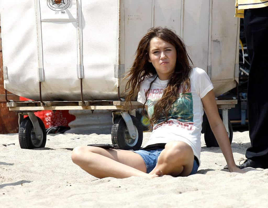 """Teen queen Miley Cyrus takes a beach break while filming a new """"Hannah Montana"""" video. <a href=""""http://www.x17online.com"""" target=""""new"""">X17 Online</a> - July 5, 2008"""