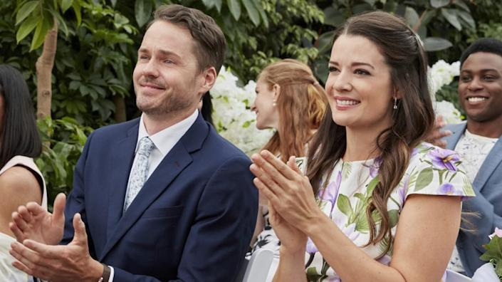 """Wedding Every Weekend -- Hallmark TV Movie, Nate and Brooke are going to the same four weddings, four weekends in a row. To avoid the singles tables and set-ups, they agree to go together as """"wedding buddies."""" But what starts as a friendship soon becomes something deeper. Photo: Paul Campbell, Kimberley Sustad Credit: ©2020 Crown Media United States LLC/Photographer:Ryan Plummer Paul Campbell and Kimberley Sustad in """"Wedding Every Weekend"""" on Hallmark."""