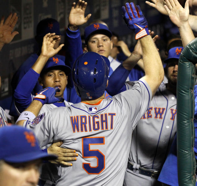 New York Mets' David Wright (5) celebrates with his teammates after hitting a solo home run against the Philadelphia Phillies in the fourth inning of a baseball game Saturday, Sept. 21, 2013, in Philadelphia. (AP Photo/H. Rumph Jr)