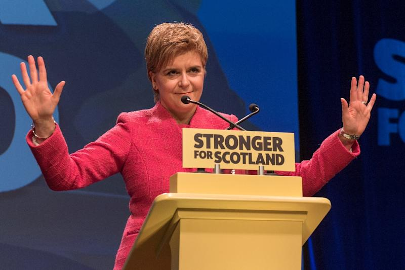 """""""The people of Scotland will have a choice,"""" First Minister Nicola Sturgeon said to loud cheers at a raucous rally of her SNP party"""