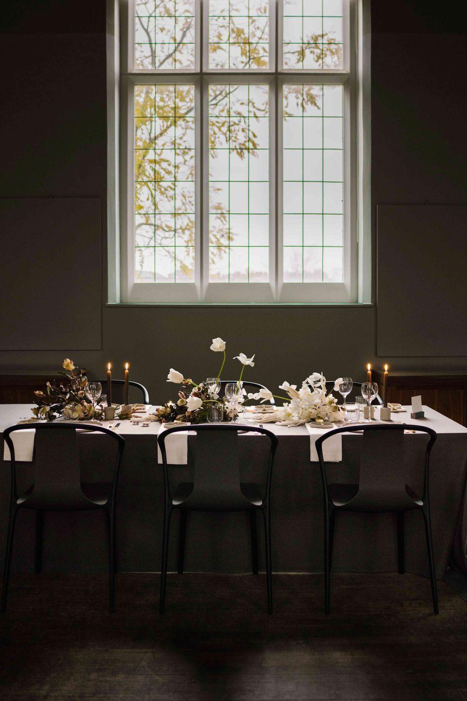 """<p>Add a shot of drama to proceedings with this contrasting black and white theme reminiscent of a Dutch master, here designed by bespoke planner and designer Anne Ladegast-Chiu of Hilde.<br><br>For similar napkins, try 'Lario Alabaster <strong>Napkins</strong>', £36 for four, Designers Guild (<u><a href=""""https://www.designersguild.com/uk/table-linen/designers-guild/lario-alabaster-table-linen/P168?gclid=Cj0KCQiAhs79BRD0ARIsAC6XpaXz1_fmMhVQEIRFb8m8pWGU-Am3y_WjwXGQXExl6ztS39cZ9Jpbkx0aAhf-EALw_wcB"""" rel=""""nofollow noopener"""" target=""""_blank"""" data-ylk=""""slk:designersguild.com"""" class=""""link rapid-noclick-resp"""">designersguild.com</a></u>). For black candles, try 'Black Dinner <strong>Candles'</strong>, £8 for six, Nordic House (<u><a href=""""https://www.nordichouse.co.uk/black-dinner-candles-p-1114.html?utm_source=nordichouse.co.uk&utm_medium=cppc&utm_campaign=campaign1&gclid=Cj0KCQiAhs79BRD0ARIsAC6XpaX4BhXPe_QeIgWY5cb2uJmfVUreK_Lp0ynK4xYFdh-BdI-RCzkTFuQaAm6dEALw_wcB"""" rel=""""nofollow noopener"""" target=""""_blank"""" data-ylk=""""slk:nordichouse.co.uk"""" class=""""link rapid-noclick-resp"""">nordichouse.co.uk</a></u>). For similar candleholders, try 'Concrete Duo' <strong>candleholders</strong>, £10 each, Decorum (<u><a href=""""https://decorum-shop.co.uk/products/concrete-duo-candle-holder?variant=22991122565¤cy=GBP&utm_medium=product_sync&utm_source=google&utm_content=sag_organic&utm_campaign=sag_organic&gclid=Cj0KCQiAhs79BRD0ARIsAC6XpaXLUlaNAD1XyuLktKCmV9QKfHle_57Svcm9JF-c4POCzqZ_T9KbAFAaAlnTEALw_wcB"""" rel=""""nofollow noopener"""" target=""""_blank"""" data-ylk=""""slk:decorum-shop.co.uk)"""" class=""""link rapid-noclick-resp"""">decorum-shop.co.uk)</a></u>. For similar cutlery, try 'Old <strong>Cutlery</strong>', from £22 for a set of six, RE (<u><a href=""""https://www.re-foundobjects.com/product/view/old-cutlery?cat=33"""" rel=""""nofollow noopener"""" target=""""_blank"""" data-ylk=""""slk:re-foundobjects.com"""" class=""""link rapid-noclick-resp"""">re-foundobjects.com</a></u>). For similar side plates, try 'Hasami Porcelain Gloss Grey <strong>Pla"""