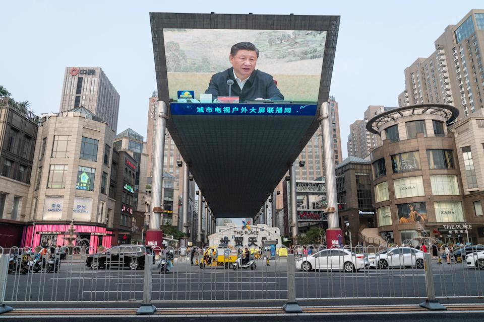 A screen shows a news broadcast of Chinese President Xi Jinping in Beijing, China. Source: Getty