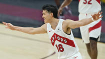 Toronto Raptors' Yuta Watanabe celebrates a three-point basket in the first half of an NBA basketball game against the Cleveland Cavaliers, Saturday, April 10, 2021, in Cleveland. (AP Photo/Tony Dejak)