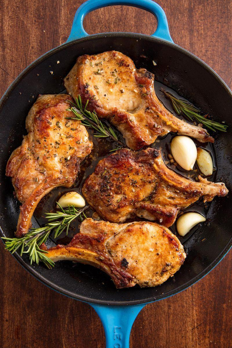 "<p>Pork chops have the potential to be juicy, tender, and flavourful, really! This oven-baked method will ensure your pork has a delicious crust and a perfectly cooked interior. </p><p>Get the <a href=""https://www.delish.com/uk/cooking/recipes/a29186909/oven-baked-pork-chops-recipe/"" rel=""nofollow noopener"" target=""_blank"" data-ylk=""slk:Garlic Rosemary Pork Chops"" class=""link rapid-noclick-resp"">Garlic Rosemary Pork Chops</a> recipe.</p>"