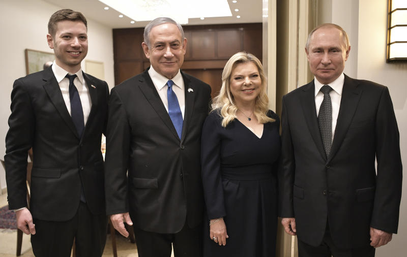 Israeli Prime Minister Benjamin Netanyahu, 2nd left, his wife Sara, son Yair, left, and Russian President Vladimir Putin pose during a meeting, in Tel-Aviv, Israel, Thursday, Jan. 23, 2020, ahead of the World Holocaust Forum, which coincides with the 75th anniversary of the liberation of the Auschwitz death camp. Dozens of world leaders have descended upon Jerusalem for the largest-ever gathering focused on commemorating the Holocaust and combating modern-day anti-Semitism. (Aleksey Nikolskyi, Sputnik Kremlin Pool Photo via AP)