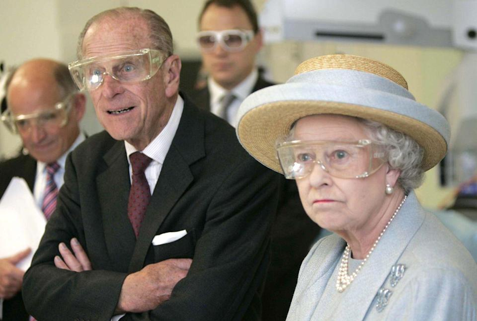 <p>The Queen and the Duke of Edinburgh wear protective eye-wear as they tour University College Hospital in October 2005.</p>