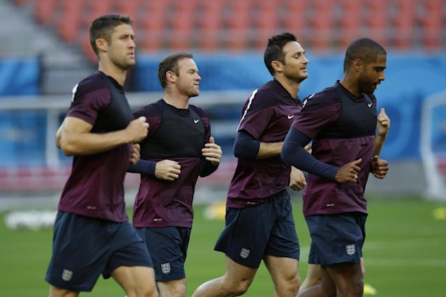 England's, from left, Gary Cahill, Wayne Rooney, Frank Lampard, and Glen Johnson jog during a training session of the England national soccer team at the Arena da Amazonia in Manaus, Brazil, Friday, June 13, 2014. England play Italy in group D of the 2014 soccer World Cup at the stadium on Saturday. (AP Photo/Matt Dunham)