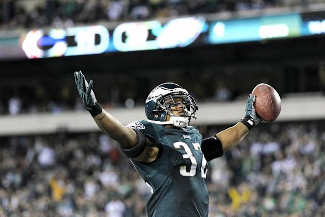 Philadelphia Eagles' Chris Polk celebrates after scoring a touchdown during the second half of an NFL football game against the Chicago Bears, Sunday, Dec. 22, 2013, in Philadelphia. (AP Photo/Michael Perez)