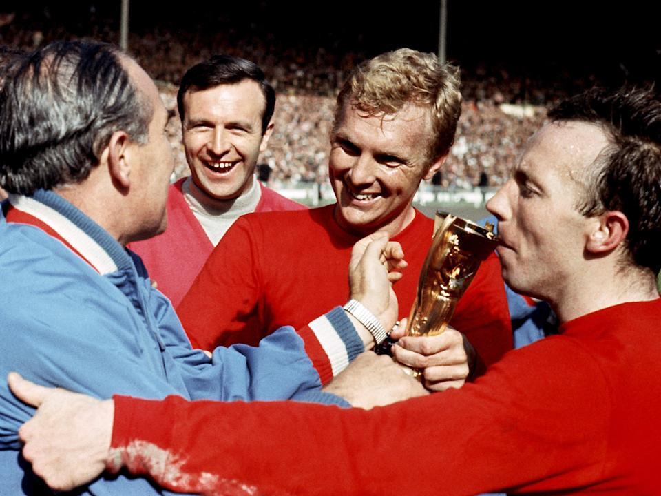 <p>Stiles kissing the World Cup with Alf Ramsey (left) and Bobby Moore (centre)</p>PA