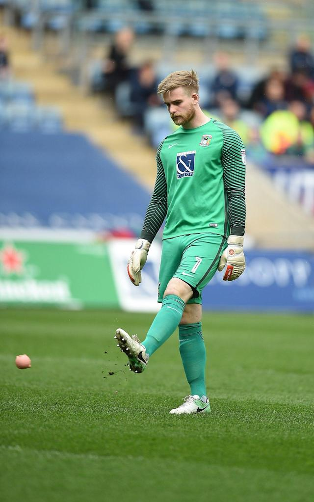 <span>Coventry Cities goalkeeper Lee Burge kicks a pig off the pitch</span> <span>Credit: Rex </span>