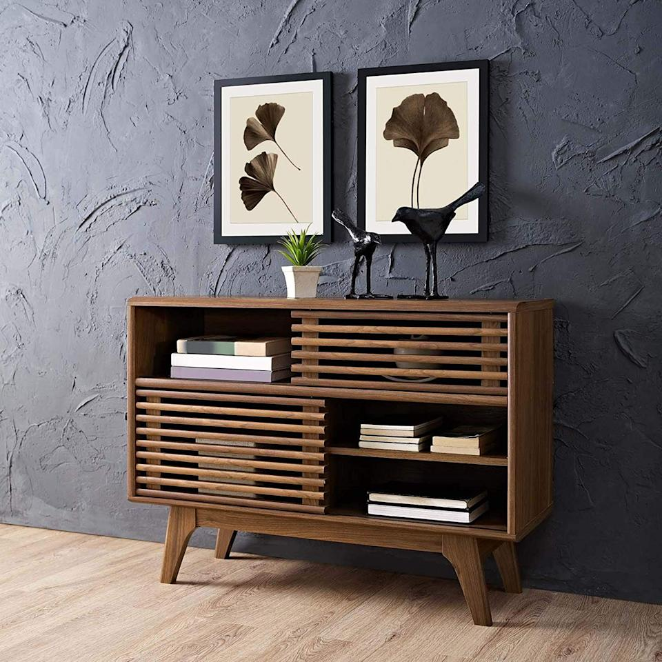 """<h3><a href=""""https://www.amazon.com/Modway-EEI-2542-WAL-Render-Display-Walnut/dp/B078K9V22B/ref=sr_1_32"""" rel=""""nofollow noopener"""" target=""""_blank"""" data-ylk=""""slk:Modway Two-Tier Wood Console"""" class=""""link rapid-noclick-resp"""">Modway Two-Tier Wood Console</a> </h3><br>Use this compact but all-encompassing unit to store everything from entryway odds and ends to entertainment essentials or kitchenware.<br><br><strong>Modway</strong> Render Mid-Century Modern Two-Tier Display Stand, $, available at <a href=""""https://www.amazon.com/Modway-EEI-2542-WAL-Render-Display-Walnut/dp/B078K9V22B/ref=sr_1_32"""" rel=""""nofollow noopener"""" target=""""_blank"""" data-ylk=""""slk:Amazon"""" class=""""link rapid-noclick-resp"""">Amazon</a>"""