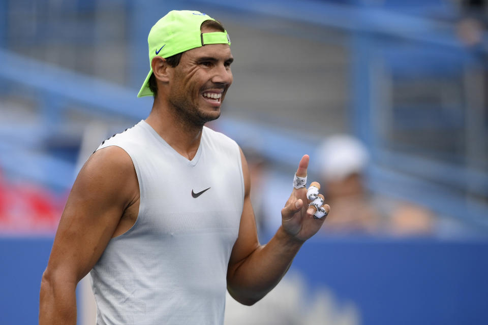 Rafael Nadal, of Spain, reacts at practice at the Citi Open tennis tournament, Saturday, July 31, 2021, in Washington. (AP Photo/Nick Wass)
