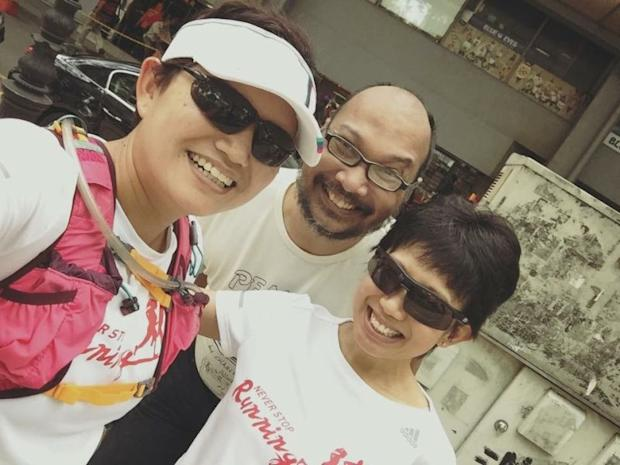 Lyana Khairuddin (left) is seen here with fellow runner Evelyn Ang (right) and with their friend Ahmad Azrai in the background. ― Picture courtesy of Lyana Khairuddin