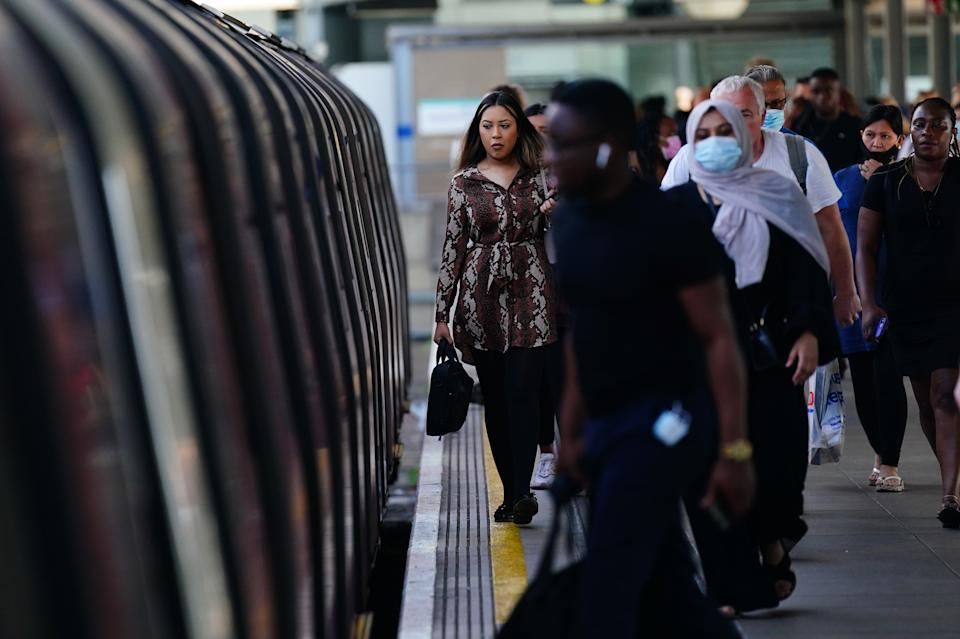 Commuters, some not wearing facemasks, at Stratford station at 0830 in London after the final legal Coronavirus restrictions were lifted in England. Picture date: Monday July 19, 2021.