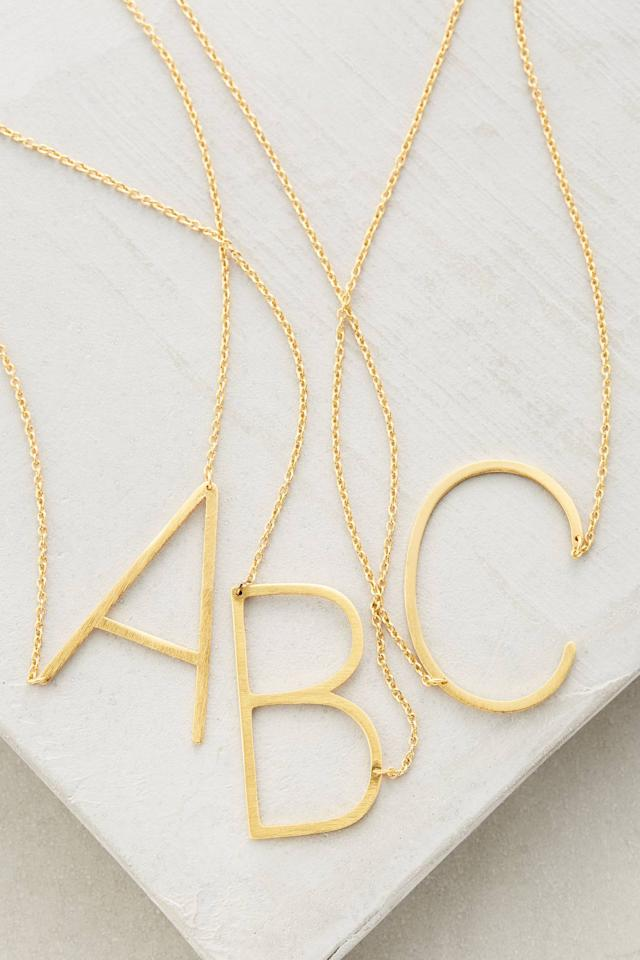 """<p><strong>Anthropologie</strong></p><p>anthropologie.com</p><p><strong>$38.00</strong></p><p><a href=""""https://go.redirectingat.com?id=74968X1596630&url=https%3A%2F%2Fwww.anthropologie.com%2Fshop%2Fblock-letter-monogram-necklace&sref=http%3A%2F%2Fwww.housebeautiful.com%2Fentertaining%2Fholidays-celebrations%2Fg29024195%2Fgifts-for-teen-girls%2F"""" target=""""_blank"""">BUY NOW</a></p><p>A modern take on personalized jewelry, this oversized initial pendant is a trendy gift she'll wear all the time. </p>"""