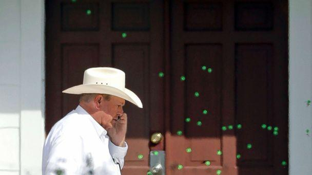 PHOTO: Wilson County Sheriff Joe Tackitt Jr. walks past the front doors where bullet holes were marked by police at the First Baptist Church, Tuesday, Nov. 7, 2017, in Sutherland Springs, Texas.  (David J. Phillip/AP)