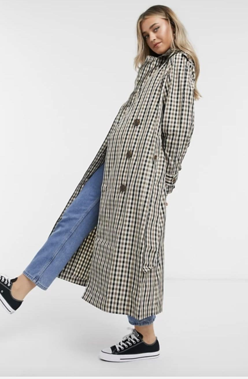 <p>This <span>ASOS Check Trench</span> ($70, originally $103) is great to throw on for any outing.</p>
