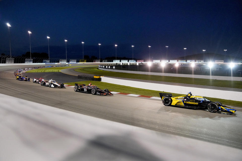 Cars race under the lights during an IndyCar auto race at World Wide Technology Raceway on Saturday, Aug. 21, 2021, in Madison, Ill. (AP Photo/Jeff Roberson)
