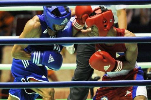 Mark Anthony Barriga (R) of Philippines fights with Hitarihun Agust of Indonesia (L)