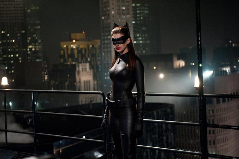 """This undated film image released by Warner Bros. Pictures shows Anne Hathaway as Catwoman in a scene from the action thriller """"The Dark Knight Rises."""" A gunman in a gas mask barged into a crowded Denver-area theater during a midnight premiere of the Batman movie on Friday, July 20, 2012, hurled a gas canister and then opened fire, killing 12 people and injuring at least 50 others in one of the deadliest mass shootings in recent U.S. history. (AP Photo/Warner Bros. Pictures, Ron Phillips)"""