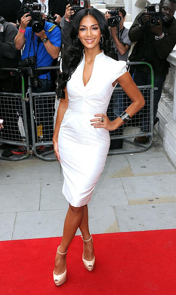 "And last but not least we have former Pussycat Doll Nicole Scherzinger, who killed it on the red carpet at a jam-packed ""X Factor"" press event in London in this adorable cocktail frock, Sethi Couture hoop earrings, Karine Sultan statement cuff, and Le Vian rings. Don't cha wish your girlfriend was hot like her?<br><br><a target=""_blank"" href=""http://bit.ly/lifeontheMlist"">Follow 2 Hot 2 Handle creator, Matt Whitfield, on Twitter!</a>"