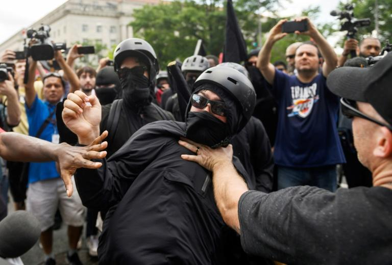 A member of the Antifa group is held back while he argues with a Trump supporter during a rally of right-wing groups in Washington on July 6, 2019. (AFP Photo/ANDREW CABALLERO-REYNOLDS)