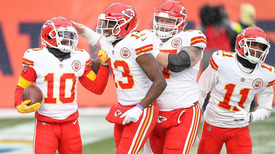 Kansas City Chiefs players Daniel Kilgore and Demarcus Robinson are seen here celebrating with teammates.