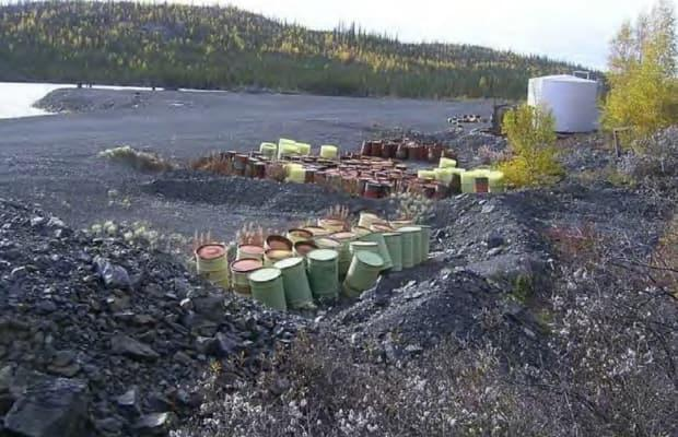 In this file photo, a cache of barrels sit near an abandoned airstrip on the Terra Mine site. The mine is among a collection of former silver, copper and bismuth mines located in the Great Bear Lake area set for remediation.   (Deline Land Corporation - image credit)