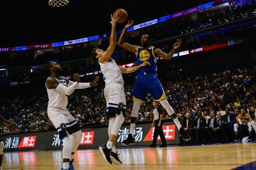 Golden State's Kevin Durant (R) in action against the Minnesota Timberwolves in Shanghai 2017. The NBA is hugely popular in China with teams like the Golden State Warriors having millions of followers