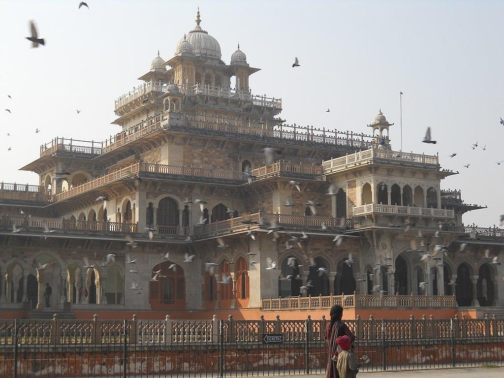 """<p>The City Palace was constructed in the 18th century by Sawai Jai Singh II, the ruler of Amber. It was the seat of the Maharaja of Jaipur, the head of the Kachwaha Rajput clan. The palace is a beautiful amalgamation of various styles of architecture, namely the Mughal, Rajputana and European styles. The integrated pink walls and structures are a part of that heritage, which gives the city its label of the Pink City. (Image: <a rel=""""nofollow"""" href=""""https://commons.wikimedia.org/wiki/File:City_Palace_Jaipur_1.jpg"""">Wikimedia Commons</a>) </p>"""