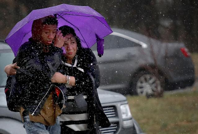 <p>A student from Great Mills High School is comforted by a guardian while being picked up at Leonardtown High School following a school shooting at Great Mills High School March 20, 2018 in Leonardtown, Md. (Photo: Win McNamee/Getty Images) </p>
