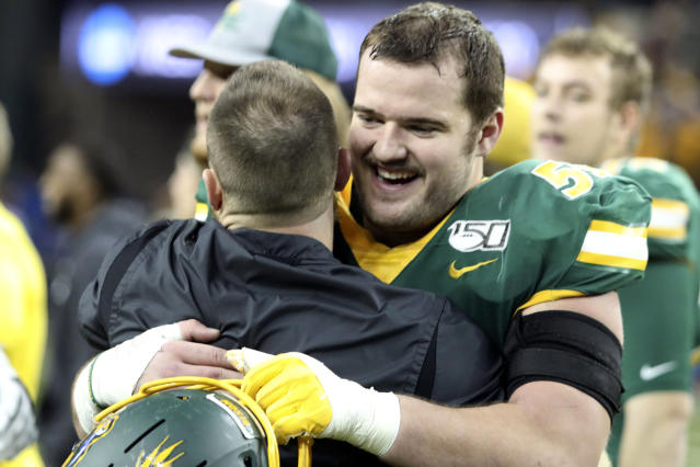 North Dakota State's Karson Schoening celebrates after their 42-14 win over Montana State in an FCS playoff NCAA college football game, Saturday, Dec. 21, 2019, in Fargo, N.D. (AP Photo/Bruce Crummy)