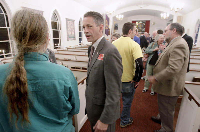 The Republican candidate for the Massachusetts 10th congressional district, Jeff Perry, center, talks with John York, left, after a candidate's forum at the First Baptist Church in Pocasset, Mass., Tuesday, Oct. 12, 2010. (AP Photo/Stephan Savoia)