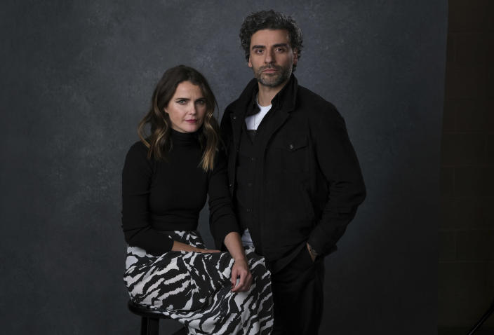 """This Dec. 3, 2019 photo shows Keri Russell, left, and Oscar Isaac posing for a portrait to promote their film """"Star Wars: The Rise of Skywalker"""" in Pasadena, Calif. (AP Photo/Chris Pizzello)"""