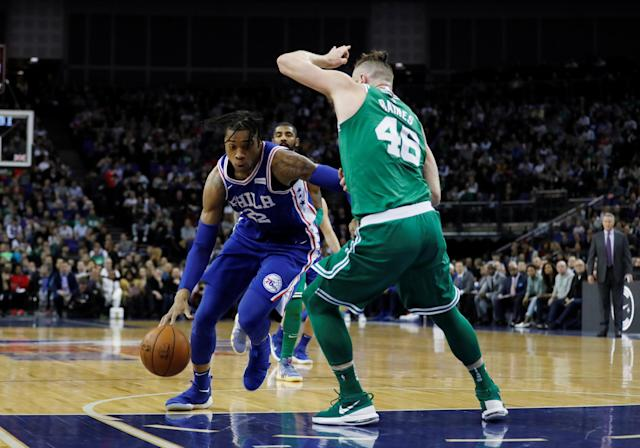Basketball - NBA - Boston Celtics vs Philadelphia 76ers - O2 Arena, London, Britain - January 11, 2018 Boston Celtics' Aron Baynes in action with Philadelphia 76ers' Richaun Holmes REUTERS/Matthew Childs