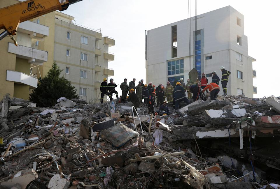 Emergency personnel work on debris of a collapsed building in the town of Durres, following Tuesday's powerful earthquake that shook Albania, November 27, 2019. REUTERS/Florion Goga