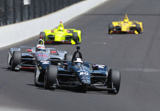 Ed Carpenter leads Will Power, of Australia, into the first turn during the final practice session for the IndyCar Indianapolis 500 auto race at Indianapolis Motor Speedway, in Indianapolis Friday, May 25, 2018. (AP Photo/R Brent Smith)