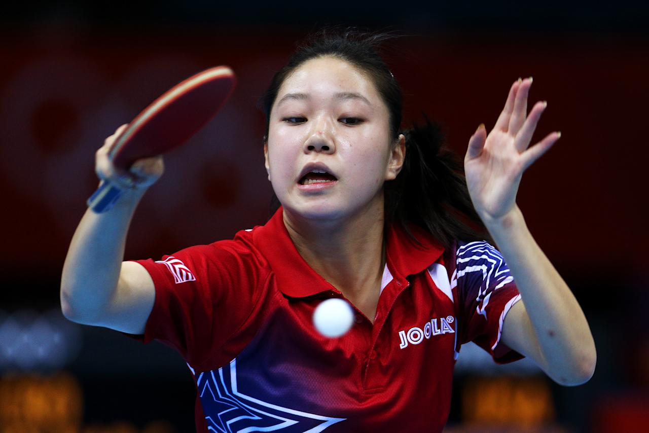 LONDON, ENGLAND - JULY 28:  Lily Zhang of the United States plays a forehand against Cornelia Molnar of Croatia during their Women's Singles Table Tennis match on Day 1 of the London 2012 Olympic Games at ExCeL on July 28, 2012 in London, England.  (Photo by Feng Li/Getty Images)