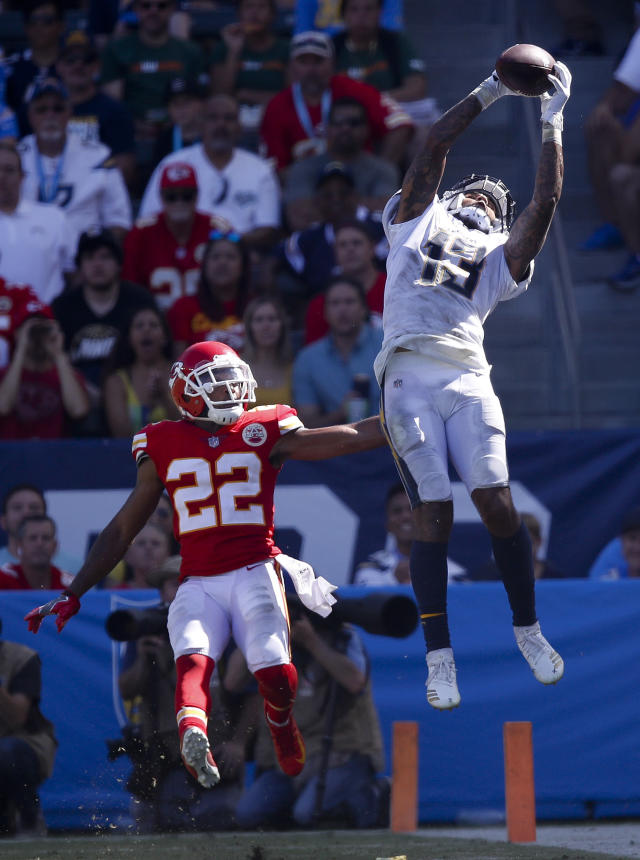 <p>Los Angeles Chargers wide receiver Keenan Allen, right, catches a touchdown pass ahead of Kansas City Chiefs defensive back Orlando Scandrick during the second half of an NFL football game Sunday, Sept. 9, 2018, in Carson, Calif. (AP Photo/Jae C. Hong) </p>