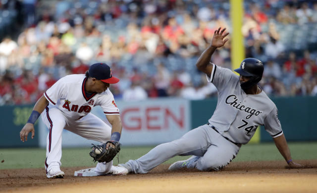 Chicago White Sox's Eloy Jimenez, right, slides safely into second base next to Los Angeles Angels shortstop Wilfredo Tovar, advancing on a wild pitch during the second inning of a baseball game Saturday, Aug. 17, 2019, in Anaheim, Calif. (AP Photo/Marcio Jose Sanchez)