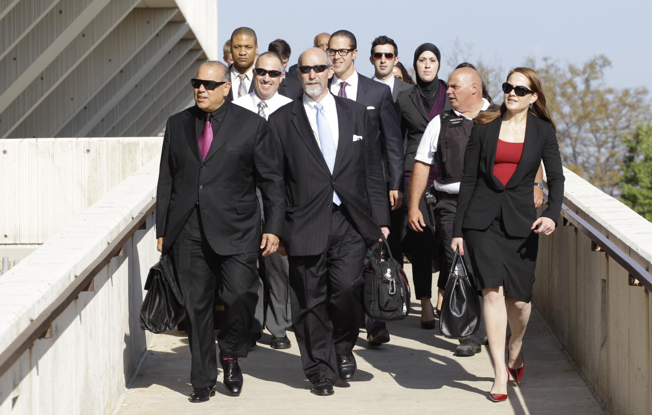 Members of Drew Peterson's defense team leave the Will County Courthouse, Tuesday, Sept. 4, 2012, in Joliet, Ill. after closing arguments in Peterson's murder trial. Peterson is charged in the 2004 death of his third wife Kathleen Savio. Jurors are expected to begin deliberating tomorrow. (AP Photo/M. Spencer Green)