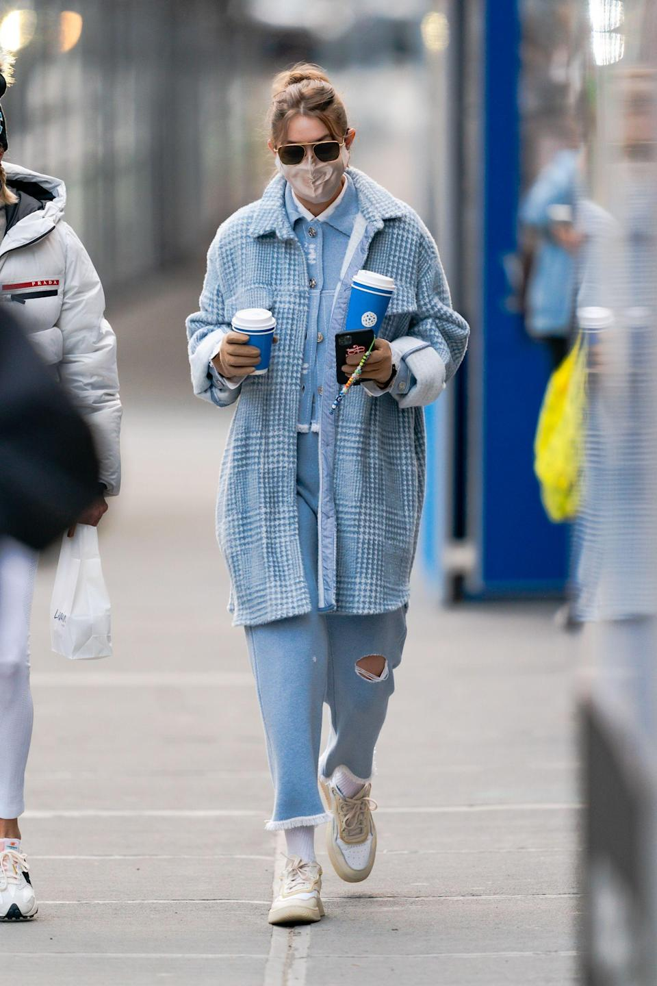 When in doubt, go for a full monochromatic look. Gigi chose baby blue as her color of choice for this stroll around NYC with her newborn.